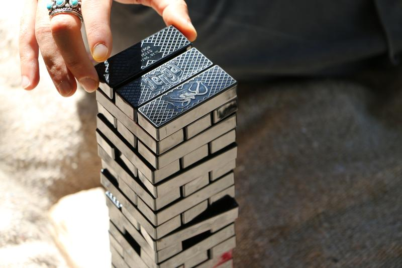 Person playing with a jenga set from Bureo on EarthHero that features sea animals and is made with recycled fishing net.